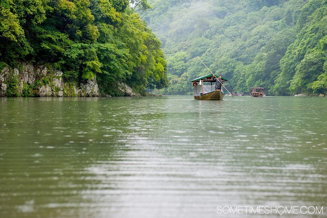 12 Inspiring Photos of Kyoto Japan on Sometimes Home travel blog. Picture of Arashiyama River in the rain.
