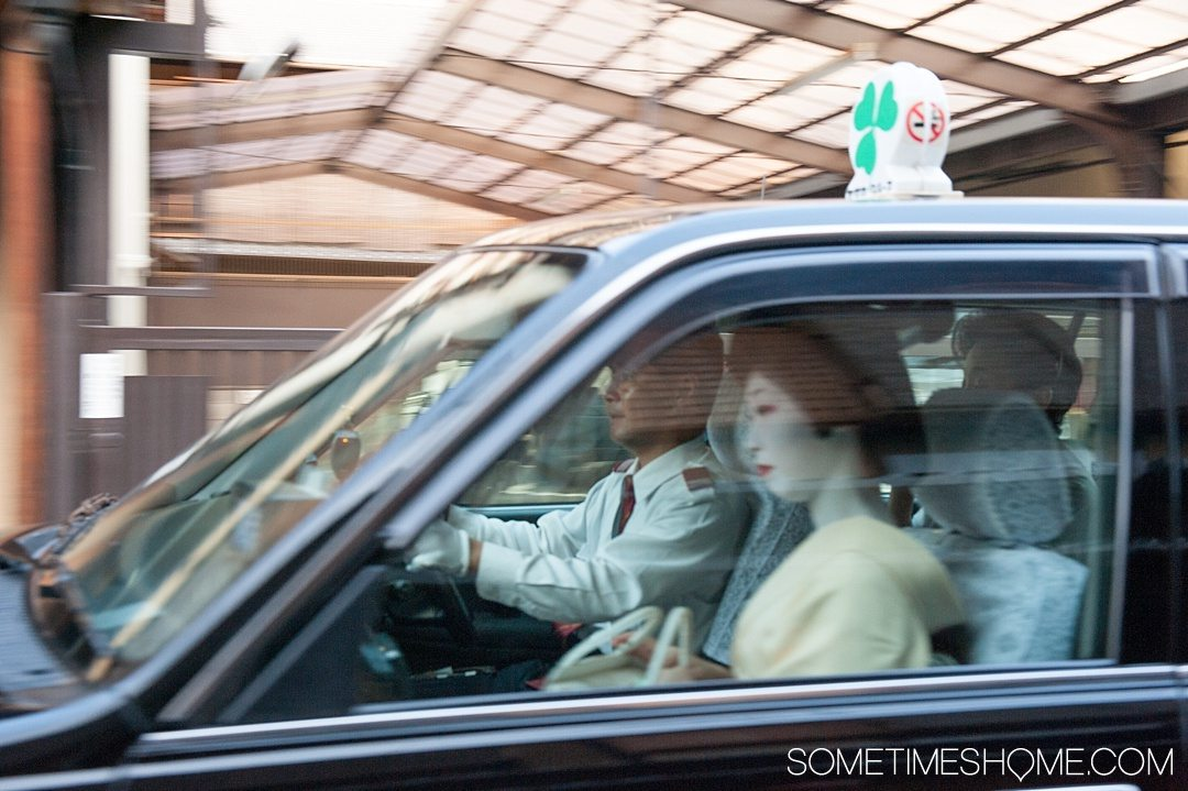 12 Inspiring Photos of Kyoto Japan on Sometimes Home travel blog. Picture of Geisha women in a taxi cab in the old Gion district of the city.