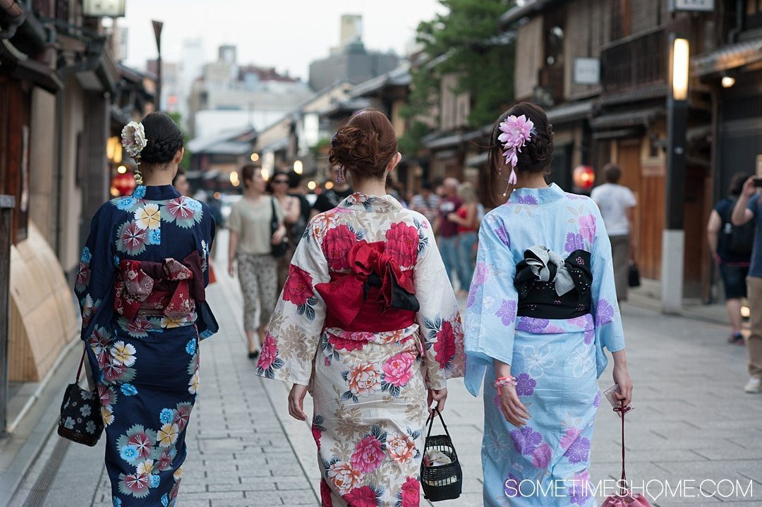 12 Inspiring Photos of Kyoto Japan on Sometimes Home travel blog. Picture of Japanese women dressed in traditional Kimonos in the Gion district.