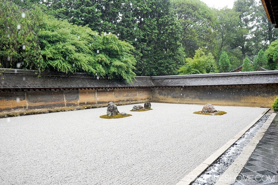 12 Inspiring Photos of Kyoto Japan on Sometimes Home travel blog. Picture of Japanese zen rock garden at Ryoanji Temple.