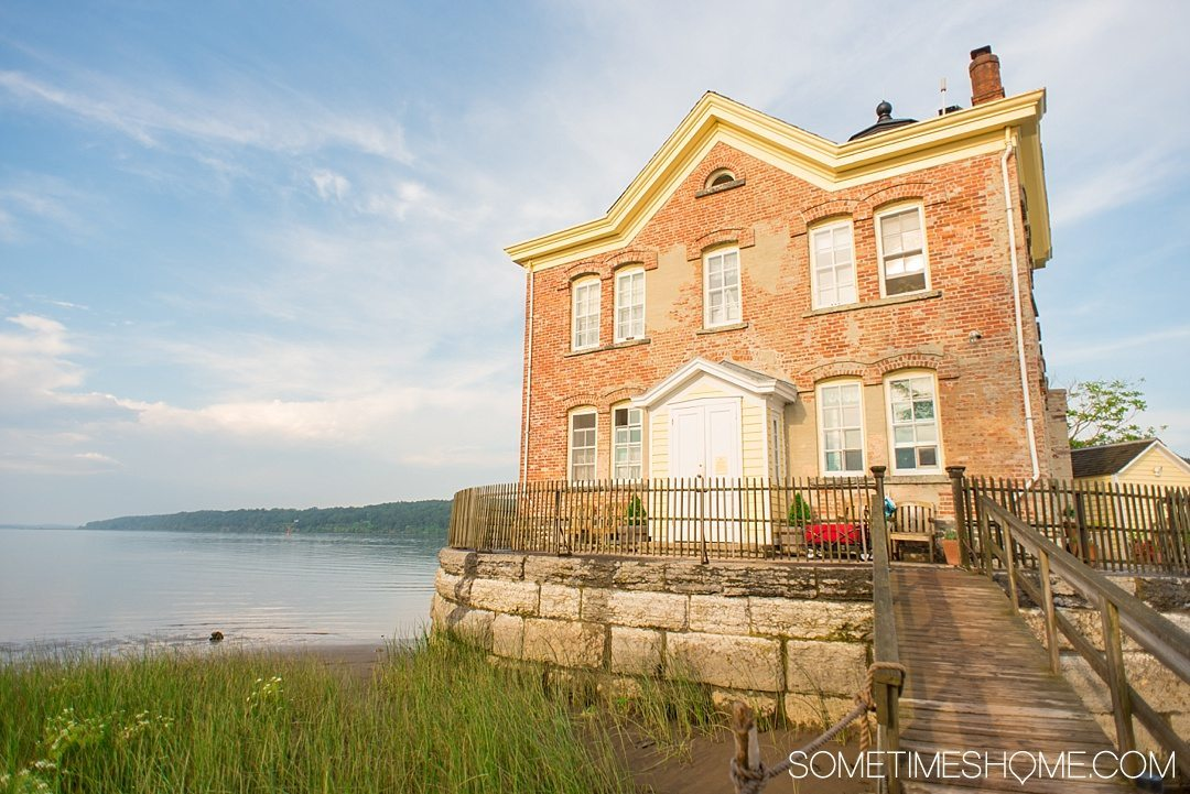Your Complete Guide to Saugerties, New York on Sometimes Home travel blog. Photo of the Saugerties Lighthouse.
