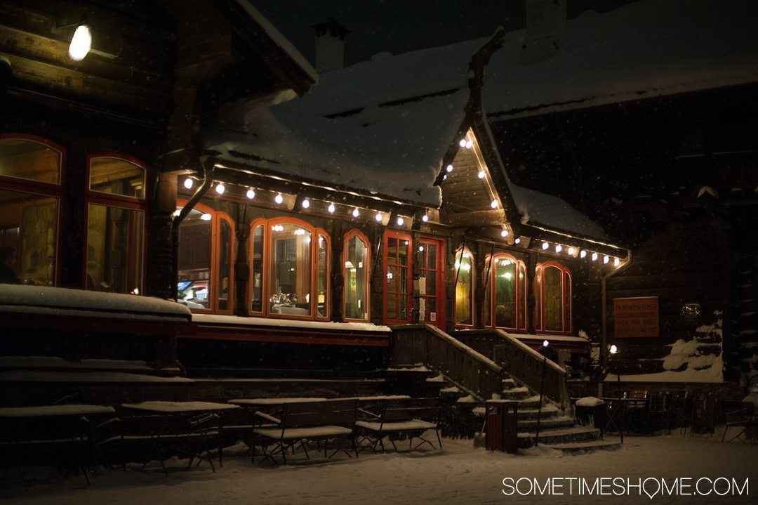 Reasons Why January is the Best Time to Visit Norway with a photo of the Frognerseteren Restaurant covered in snow.
