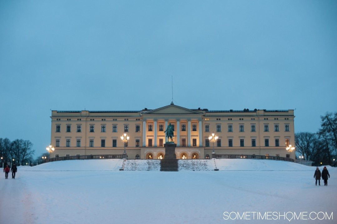 Reasons Why January is the Best Time to Visit Norway with a photo of the Royal Palace in Oslo covered with snow.