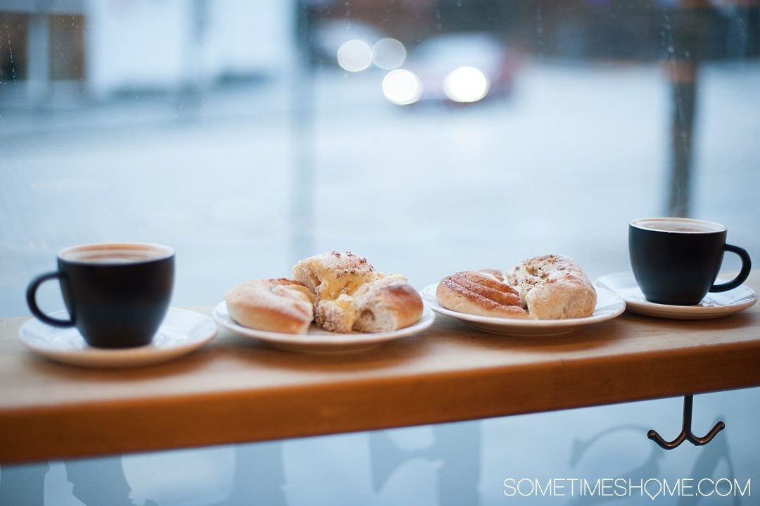 Reasons Why January is the Best Time to Visit Norway with a photo coffee and pastries in a cafe in Bergen.