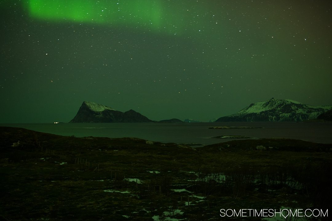 Reasons Why January is the Best Time to Visit Norway with a photo of the Northern Lights in Tromso.