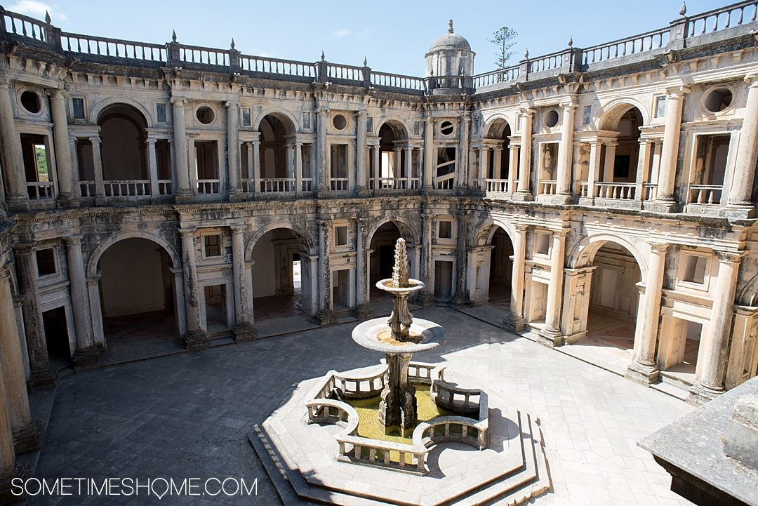 Amazing Day Trip from Lisbon to Tomar Portugal. Photos, tips and advice on Sometimes Home travel blog. Picture of the interior courtyard at Castelo de Tomar and Convent of Christ.
