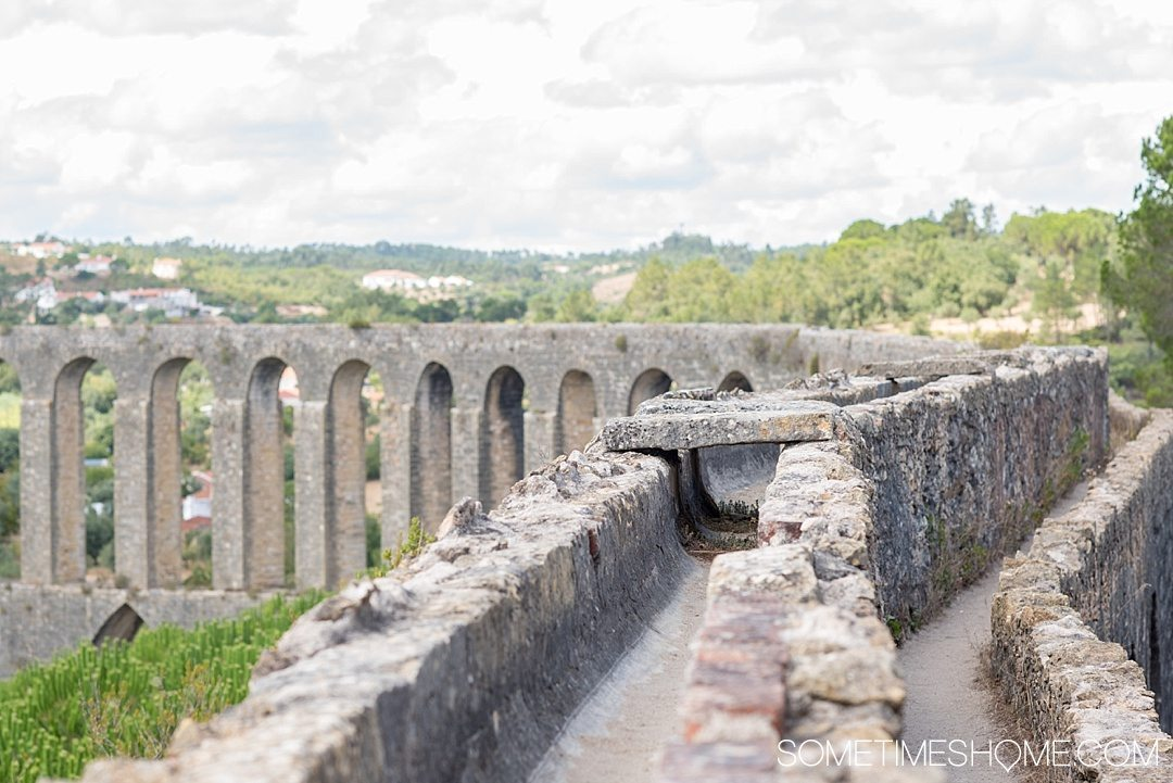 Day trip to Tomar, Portugal from Lisbon. Photos, tips and advice on Sometimes Home travel blog. Picture of Pegoes Aqueduct.