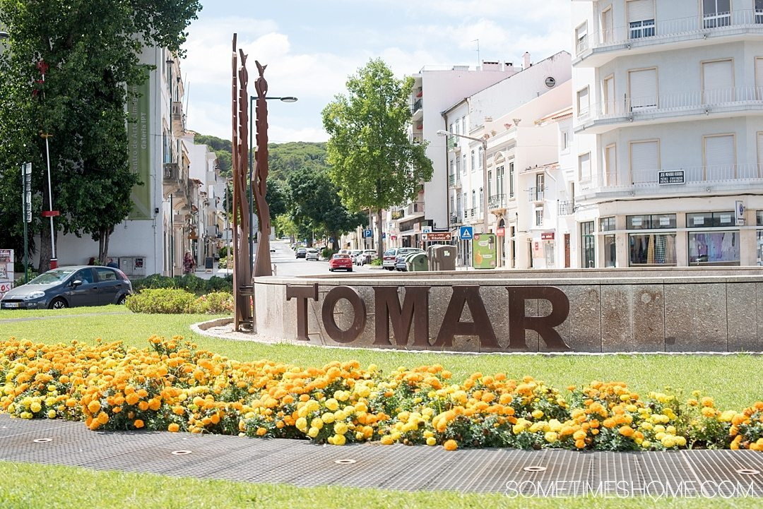 Day trip to Tomar, Portugal from Lisbon. Photos, tips and advice on Sometimes Home travel blog. Picture of the Tomar town sign.