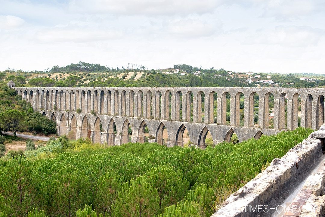 Amazing Day Trip from Lisbon to Tomar Portugal. Photos, tips and advice on Sometimes Home travel blog. Picture of Pegoes Aqueduct.