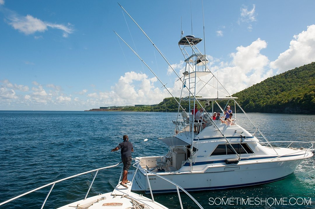 Must Do Activities to Revel In on Vacation in St. Lucia on Sometimes Home travel blog. Photos of a boat ride excursion.