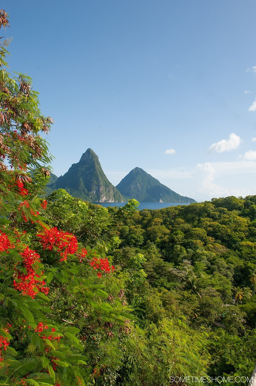 Must Do Activities to Revel In on Vacation in St. Lucia on Sometimes Home travel blog. Photos of the Piton mountains where you can hike and enjoy the view.