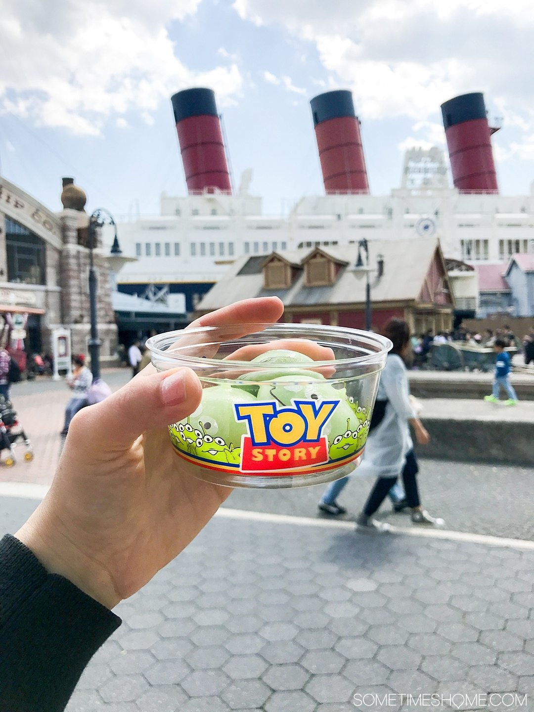 The Ultimate First-Timer's Guide to Tokyo DisneySea on Sometimes Home travel blog. Photo of a snack of Toy Story's Green Aliens in mochi form!