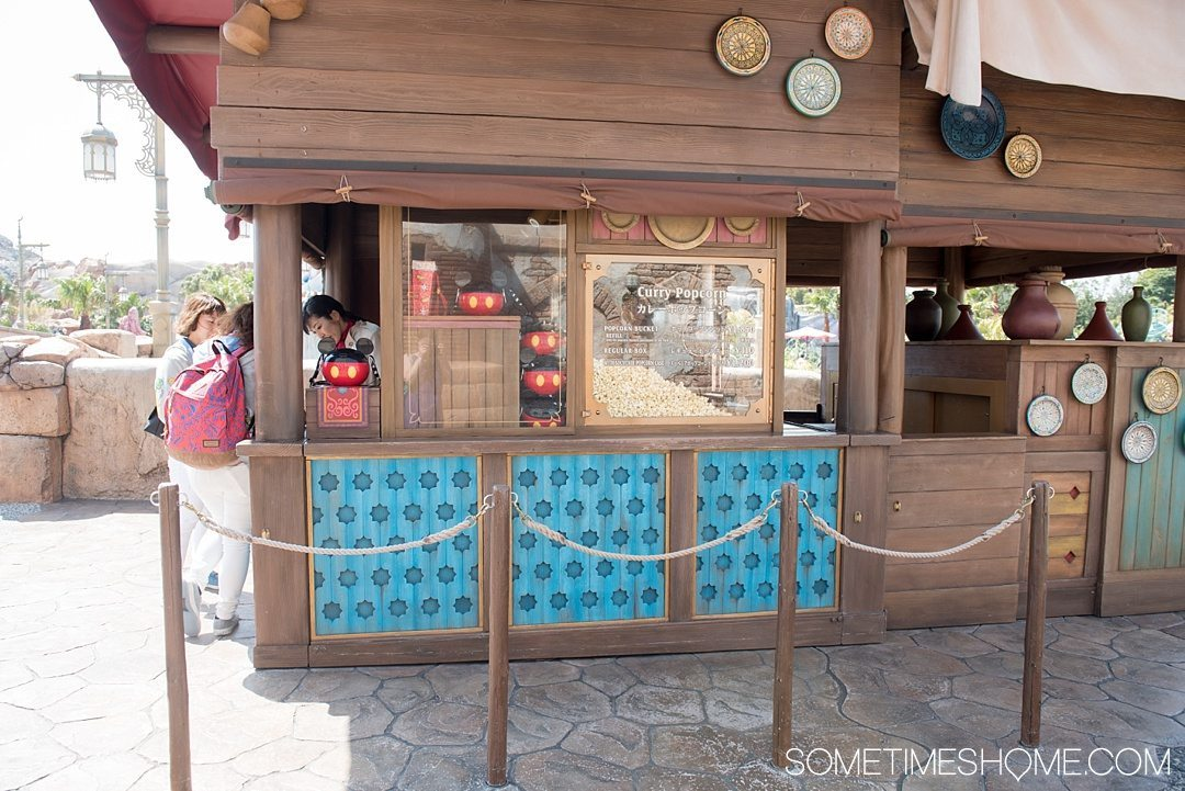 The Ultimate First-Timer's Guide to Tokyo DisneySea on Sometimes Home travel blog. Photo of a Curry flavored popcorn stand in the park.
