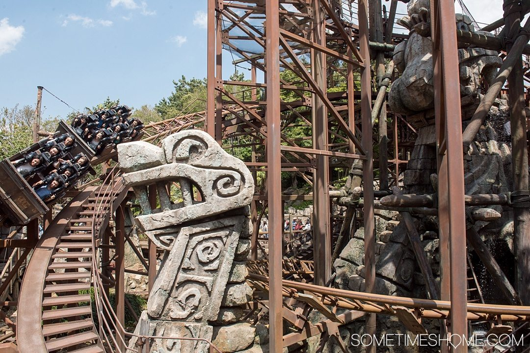 The Ultimate First-Timer's Guide to Tokyo DisneySea on Sometimes Home travel blog. Photo of the Raging Spirits roller coaster in the Lost River Delta land of the park.