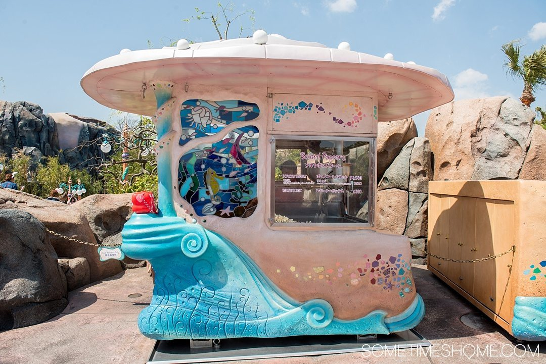 The Ultimate First-Timer's Guide to Tokyo DisneySea on Sometimes Home travel blog. Photo of a Salt flavored popcorn stand in Mermaid Lagoon.