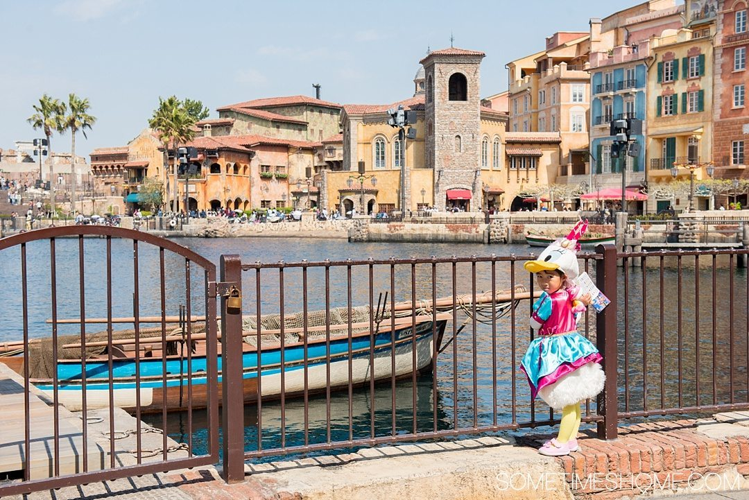 The Ultimate First-Timer's Guide to Tokyo DisneySea on Sometimes Home travel blog. Photo of a child in a complete Daisy Duck costume.