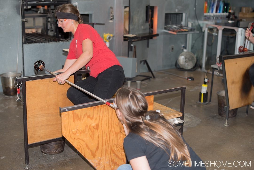 Corning Museum of Glass gift shop, hours, exhibits, photos and more on Sometimes Home travel blog. Also links to an article of what to do in Corning, New York in the Finger Lakes region. Picture of creating your own glass piece.