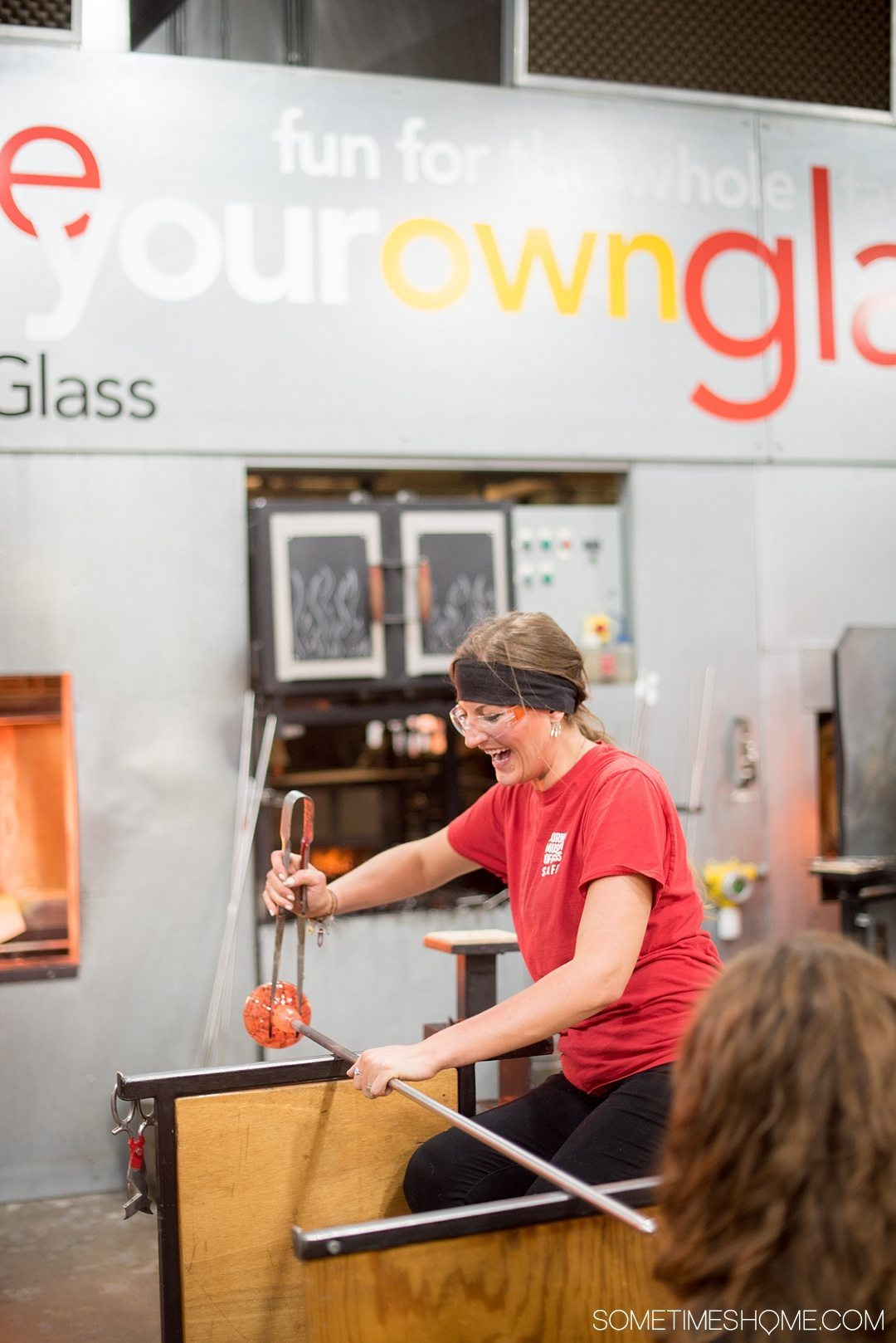 Corning Museum of Glass gift shop, hours, exhibits, photos and more on Sometimes Home travel blog. Also links to an article of what to do in Corning, New York in the Finger Lakes region. Picture of blowing your own glass piece.