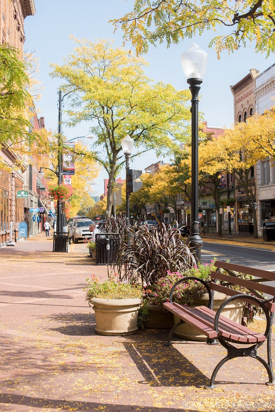 Things to do in Corning NY in the Finger Lakes region on Sometimes Home travel blog. Photo of the downtown area on W. Market Street.
