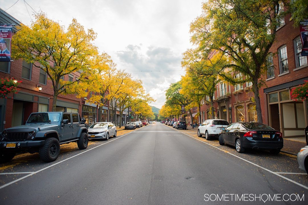 Things to do in Corning NY in the Finger Lakes region on Sometimes Home travel blog. Photo of the downtown area.