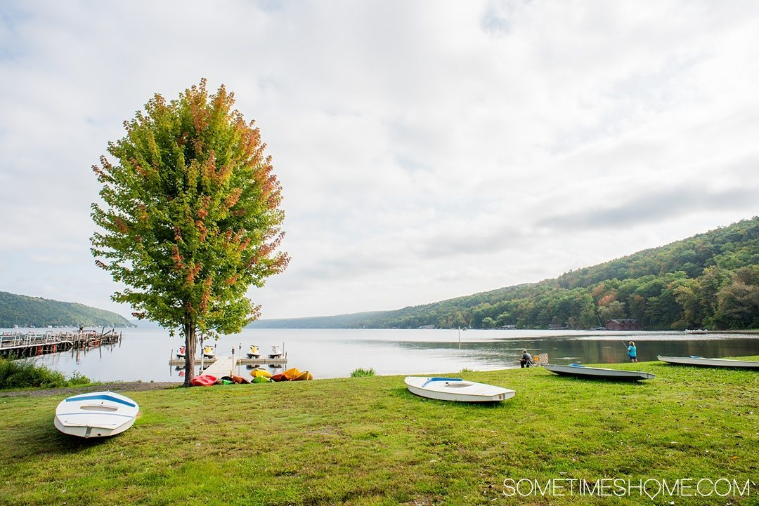 Things to do in Corning NY in the Finger Lakes region on Sometimes Home travel blog. Photo of Keuka Lake kayaking and paddle boarding.