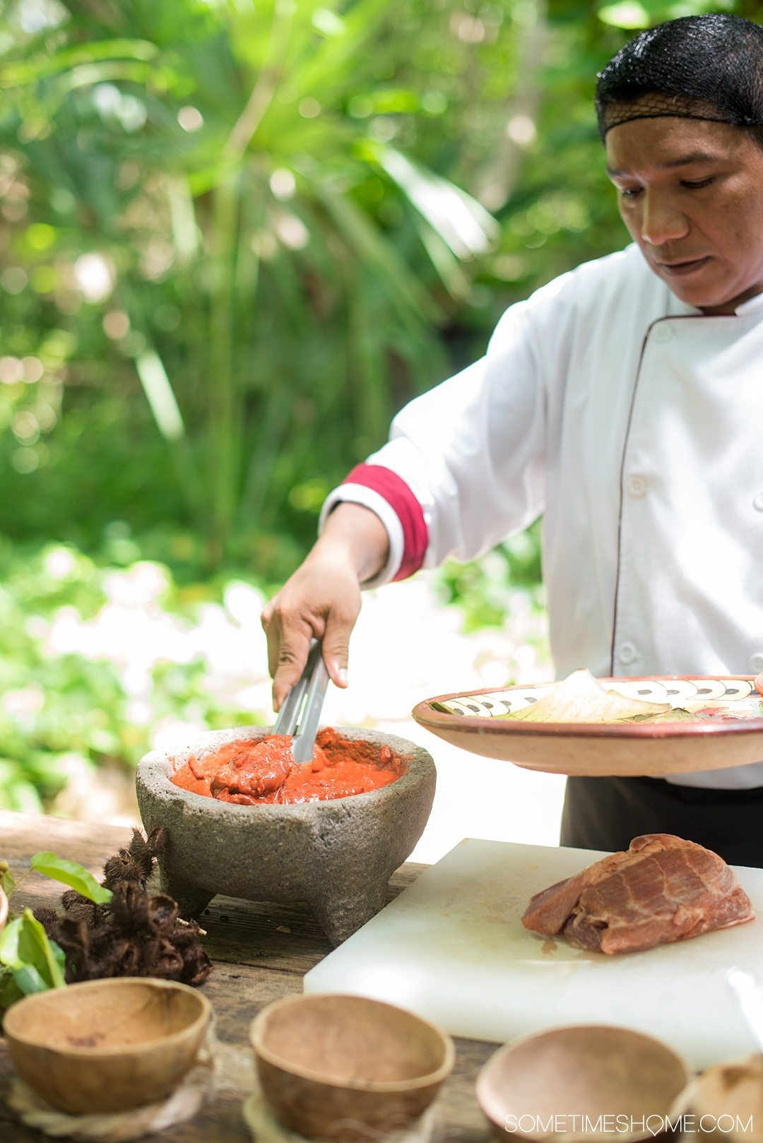 6 Unique Foods to Try in the Yucatan Peninsula on Sometimes Home travel blog. Photos of creating the marinade for Cochinita Pibil with annatto seeds.