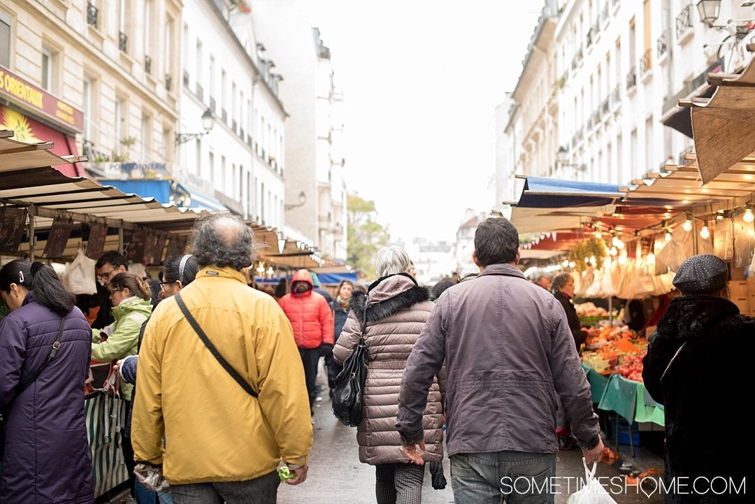 Edible Paris by Mouth Tours on Sometimes Home travel blog. A wonderful Paris food tour with a knowledgable guide, through a popular market in the city.