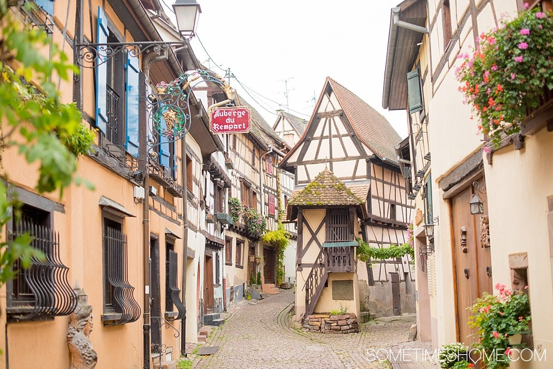 Tips and tricks to know visiting Colmar France with travel information and beautiful photography of this fairy tale village, particularly known for its Christmas markets during winter, in the Alsace region by Germany. #ColmarFrance #fairytalecity #AlsaceFrance