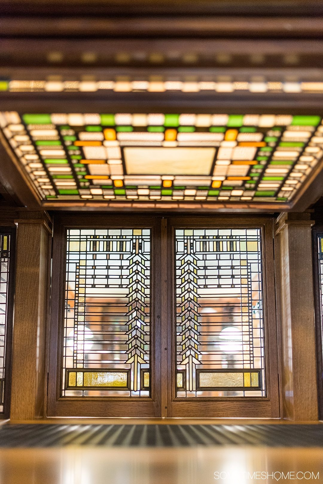 Buffalo's Darwin Martin House attraction in New York, designed by Frank Lloyd Wright. This downtown house is a wonderful place to visit whether you travel to Buffalo in winter, spring, summer or fall. It has an important place in art history and the photography of its details, including the handmade Arts and Crafts style stained glass windows - speak to that. Click through to get valuable information and insight into a visit to the home as well. #BuffaloNY #BuffaloNewYork #FrankLloydWright #ResidentialArchitecture #HistoricArchitecture #TravelBUF #VisitBuffalo #DarwinMartinHouse