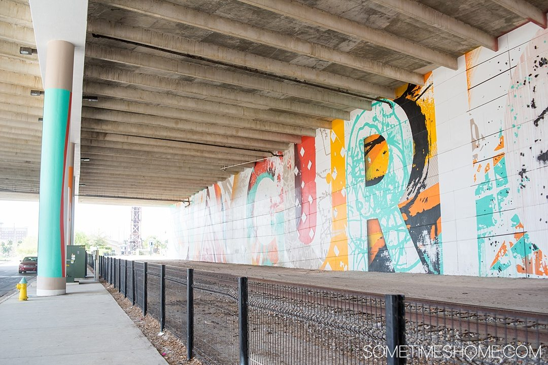 Photography of murals in the city of Tampa Bay, Florida. This is a free activity to partake in and is mostly located in the downtown neighborhood of The Heights though this one in particular is by River Walk and the Children's Museum. Embark on an adventure to take Instagram worthy pictures as we share where to find the best graffiti art of its kind. Click through to read which inspired us most and exactly where they're located. #TampaBay #TampaFlorida #StreetArt #Murals #Graffiti