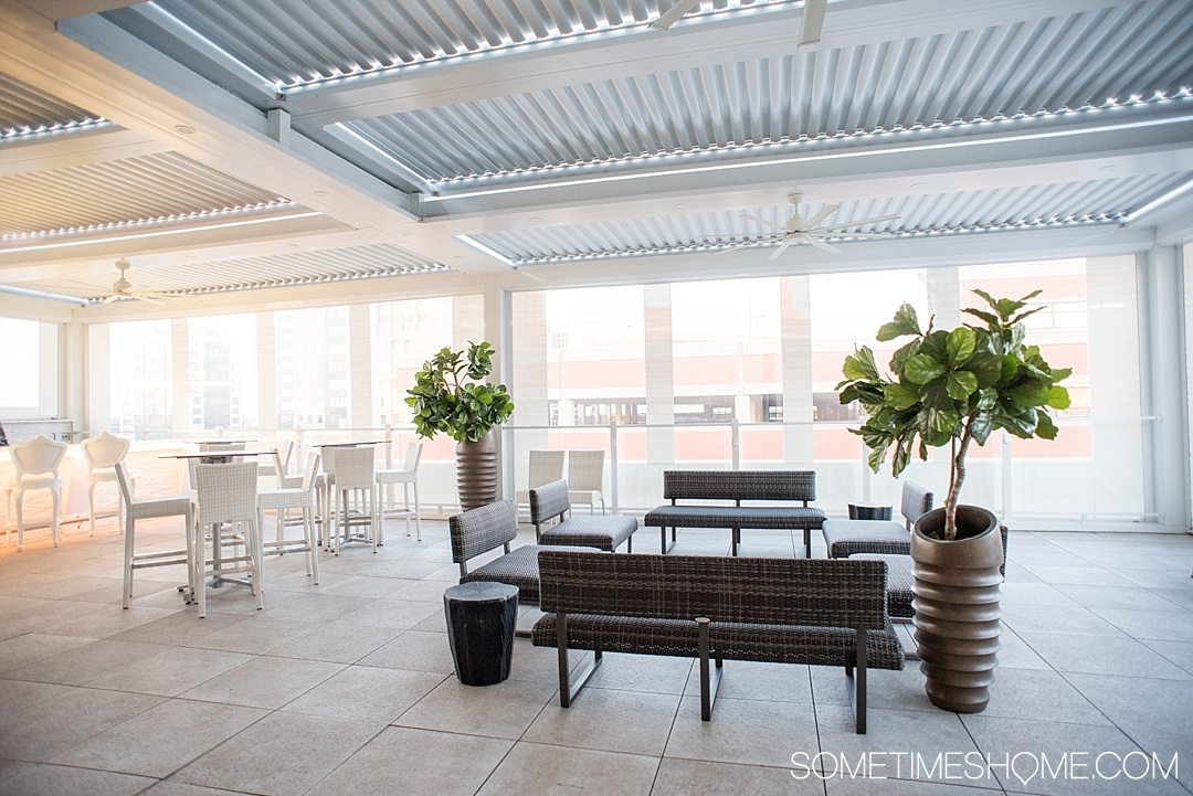 Review and photography of the Curtiss Hotel Buffalo NY. This downtown luxury accommodation has a delicious bar and restaurant, high tech rooms, and good nightlife if you're looking for things to do. The rooftop bar provides incredible views of the city. Click through for info about access! #Buffalove #BuffaloNY #TravelBUF #VisitBuffaloNiagara #Buffalo
