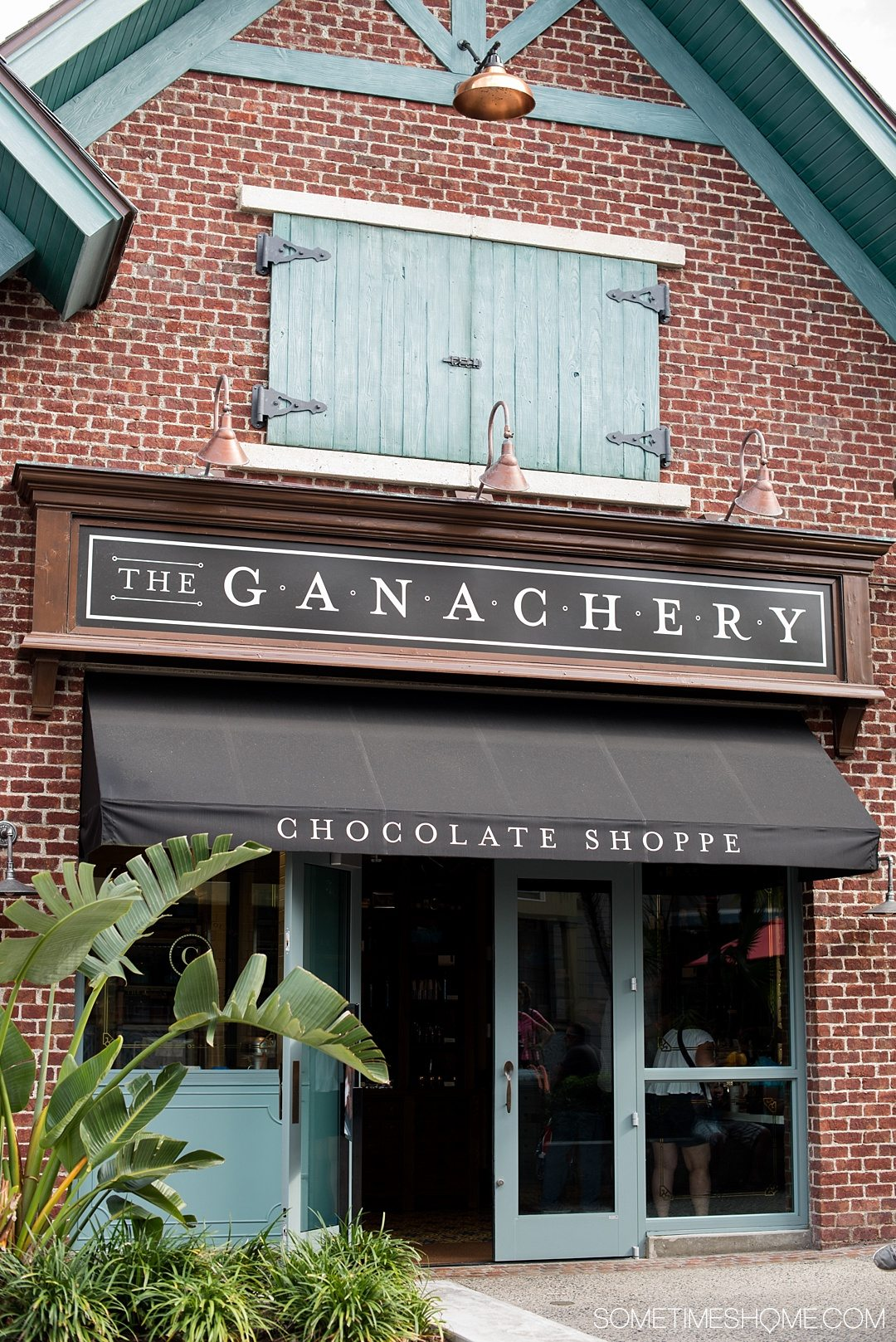 Heading to Walt Disney World? Definitely travel to Disney Springs (formally known as Downtown Disney) for a trip and indulgence in food! We dish on ideas for the best Disney Springs desserts (like ganache at The Ganachery) with photography at this Orlando, Florida themed area. Click through to Sometimes Home for detailed tips! #DisneySprings #WaltDisneyWorld #DisneyWorld