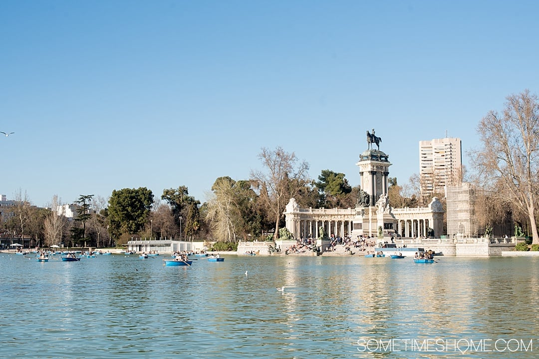 There are many things to do in Madrid, Spain. But people often wonder is one day enough in Madrid? We answer that question while showing you photography of this popular travel destination. From art, to food, and architecture attractions we have all the tips covered on Sometimes Home! This park view is worth a visit so click through for all the info! #Madrid #MadridSpain #SpanishFood #artmuseums #tapas #retiropark
