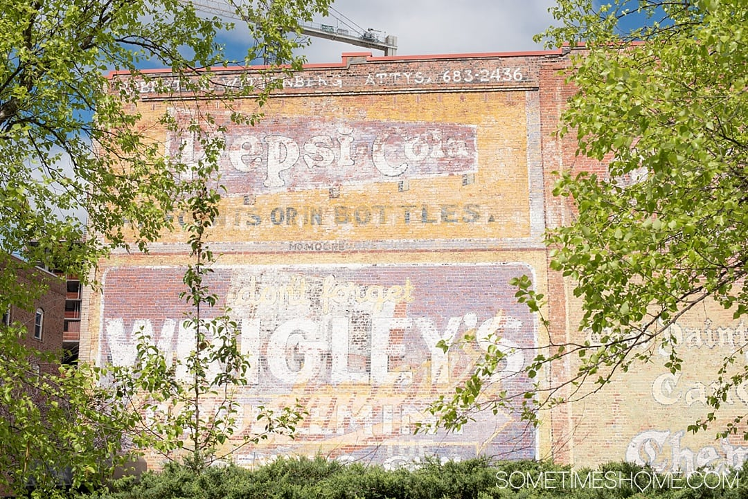 The 12 Best Photography Spots in Durham, North Carolina include art, greenery, a very special part of Duke campus, downtown scenery and more. Click through to read the specifics on this vintage brick Pepsi Co facade on Sometimes Home! #DurhamNC #NorthCarolina #DurhamNorthCarolina #Duke #VisitNC #photographyspots #photography