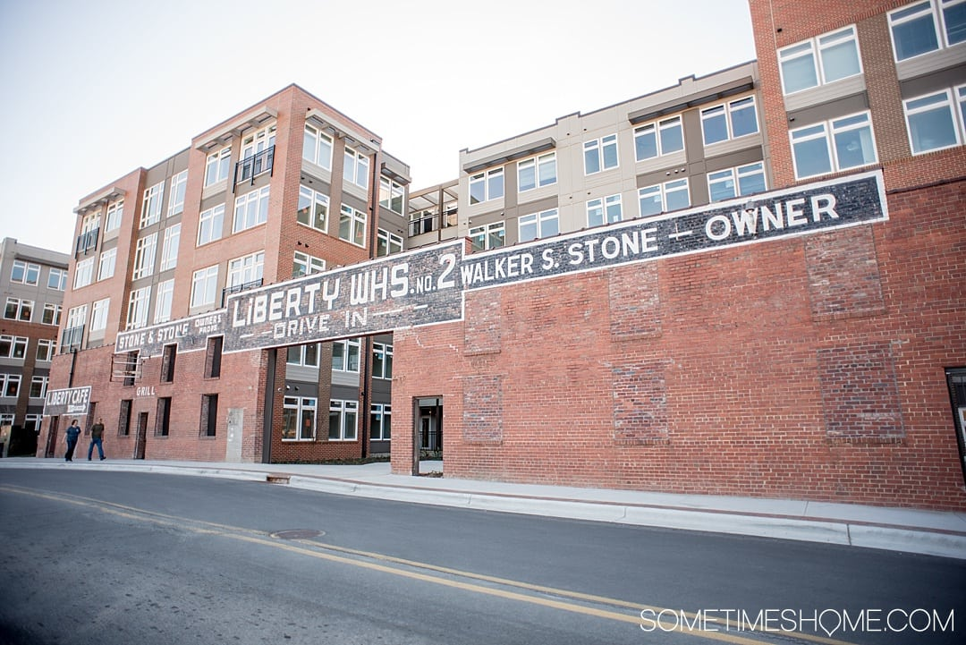 The 12 Best Photography Spots in Durham, North Carolina include art, greenery, a very special part of Duke campus, downtown scenery and more. Click through to read the specifics on this vintage brick facade on Sometimes Home! #DurhamNC #NorthCarolina #DurhamNorthCarolina #Duke #VisitNC #photographyspots #photography