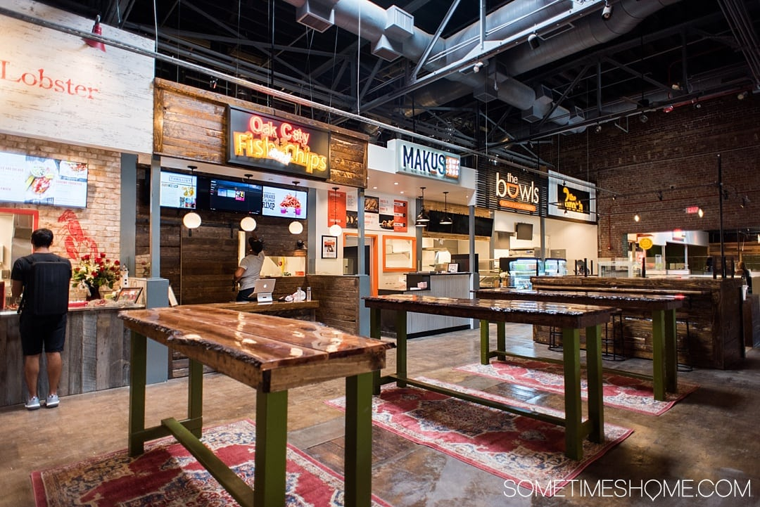One of the best things to do in the capital of North Carolina is visit Morgan Street Food Hall in Raleigh! This downtown attraction has a ton of restaurant's food options and assorted shopping in the warehouse neighborhood. If you're moving soon or have been a long time resident there's something for everyone. Click through for photography and info on Sometimes Home! #sometimeshome #MorganStreetFoodHall #RaleighNC #downtownRaleigh #ThingstodoinRaleigh #RaleighNorthCarolina #DTRaleigh #FoodHalls
