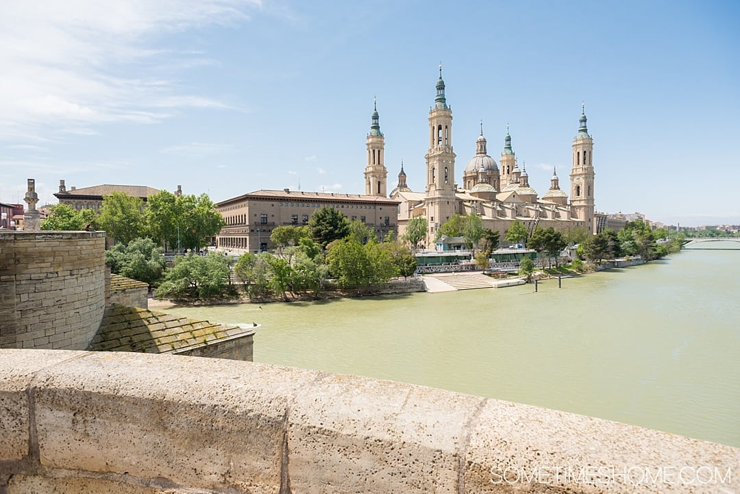 Day trip from Madrid to Zaragoza by train, in Spain, including things to do from sites and architecture, to food and street art! See amazing photography of this awesome city and gather ideas from Pilar Basilica to the moorish castle for your travel to Espana. #Zaragoza #SpainTourism #Spain #Espana #MadridDayTrip #Madrid #EbroRiver
