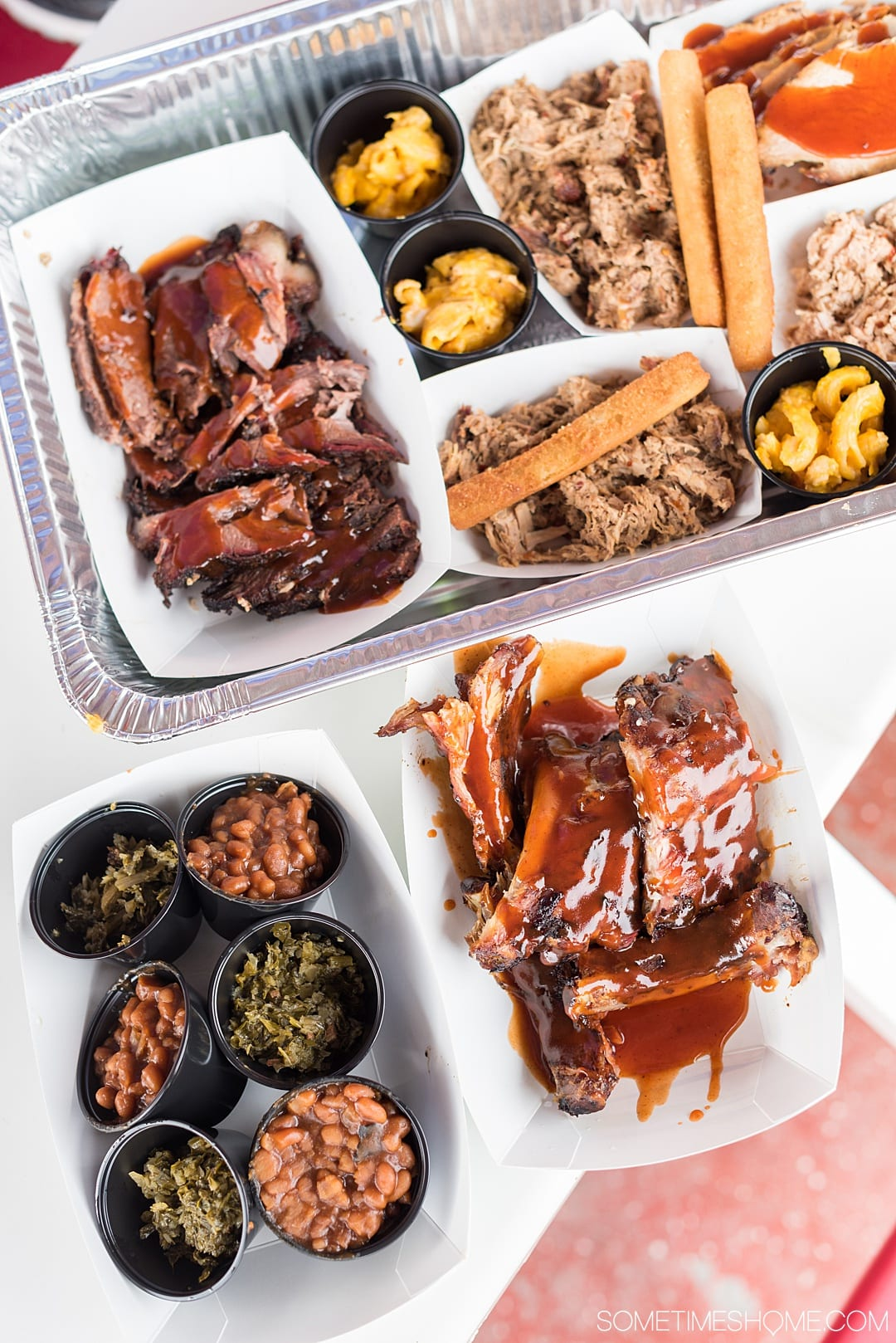 Goldsboro NC BBQ is a force to be reckoned with! The eastern vinegar based sauce of barbecue in this United States region can be sampled at a variety of restaurants, on pork, chicken, turkey or more. These restaurants have rubs to delight your taste too. Check out our article about the best places to try these southern delicacy recipes on delicious meats. #NCBBQ #barbecue #BBQ #northcarolina #GoldsboroNC #sometimeshome #vinegarBBQ #AdamsRoadside