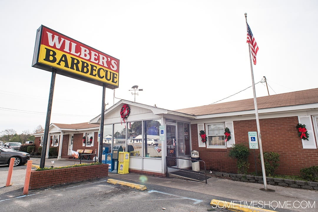 Goldsboro NC BBQ is a force to be reckoned with! The eastern vinegar based sauce of barbecue in this United States region can be sampled at a variety of restaurants, on pork, chicken, turkey or more. These restaurants have rubs to delight your taste too. Check out our article about the best places to try these southern delicacy recipes on delicious meats. #NCBBQ #barbecue #BBQ #northcarolina #GoldsboroNC #sometimeshome #vinegarBBQ #WilbersBBQ #Wilbers