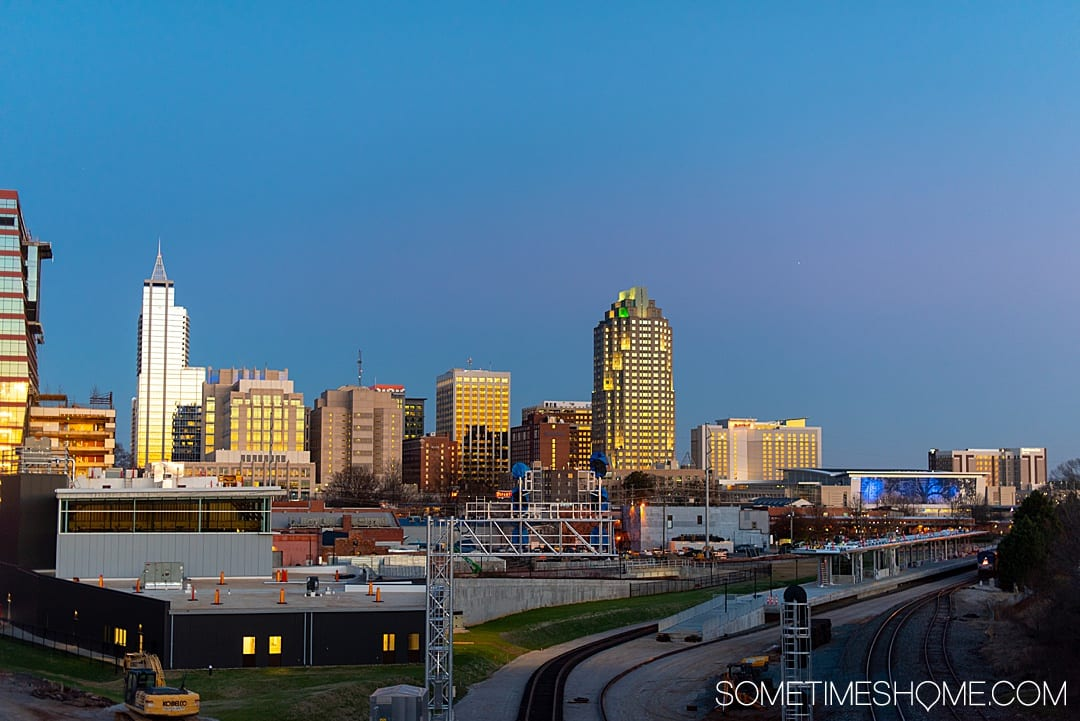 10 Best Downtown Raleigh Photography Spots on Sometimes Home travel blog. Photo of the Raleigh city skyline from Boylan Bridge. #downtownraleighphotography #raleighphotography #raleighphotographer