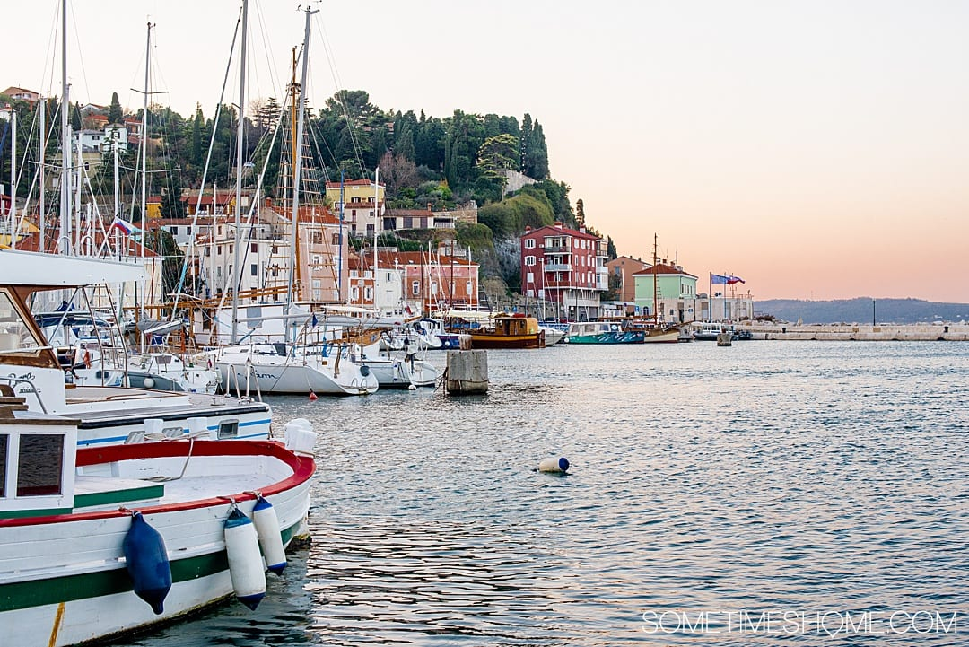Travel to this city and read our our favorite things to do in Piran, Slovenia, a beautiful coastal town on the Adriatic Sea. You'll love watching the sunrise and sunset from the beach or your hotel, trying the food, its European squares and photography opportunities. #Sometimesome #Piran #Slovenia #AdriaticCoast #AdriaticSea