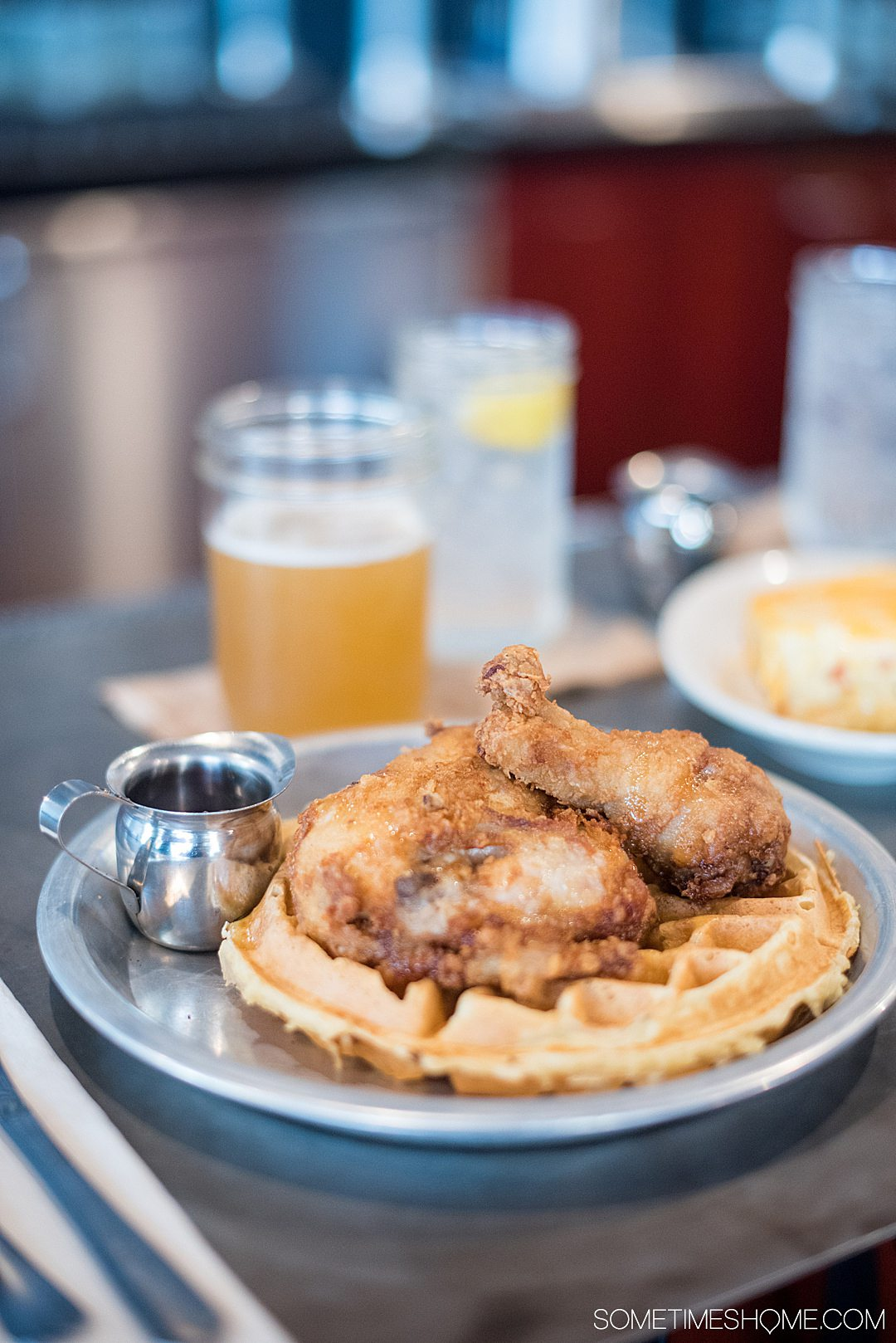 Traditional southern food to try in North Carolina or South Carolina, including soulful options like chicken and waffles, vinegar based BBQ, or appetizers like pimento cheese, drinks including Moscow Mules, and classic fried green tomatoes or shrimp n grits. We recommend restaurants in Raleigh to Asheville and beyond to try these southern style dishes. #northcarolina #southcarolina #southerndishes #southernfood #shrimpngrits #friedgreentomatoes #sometimeshome
