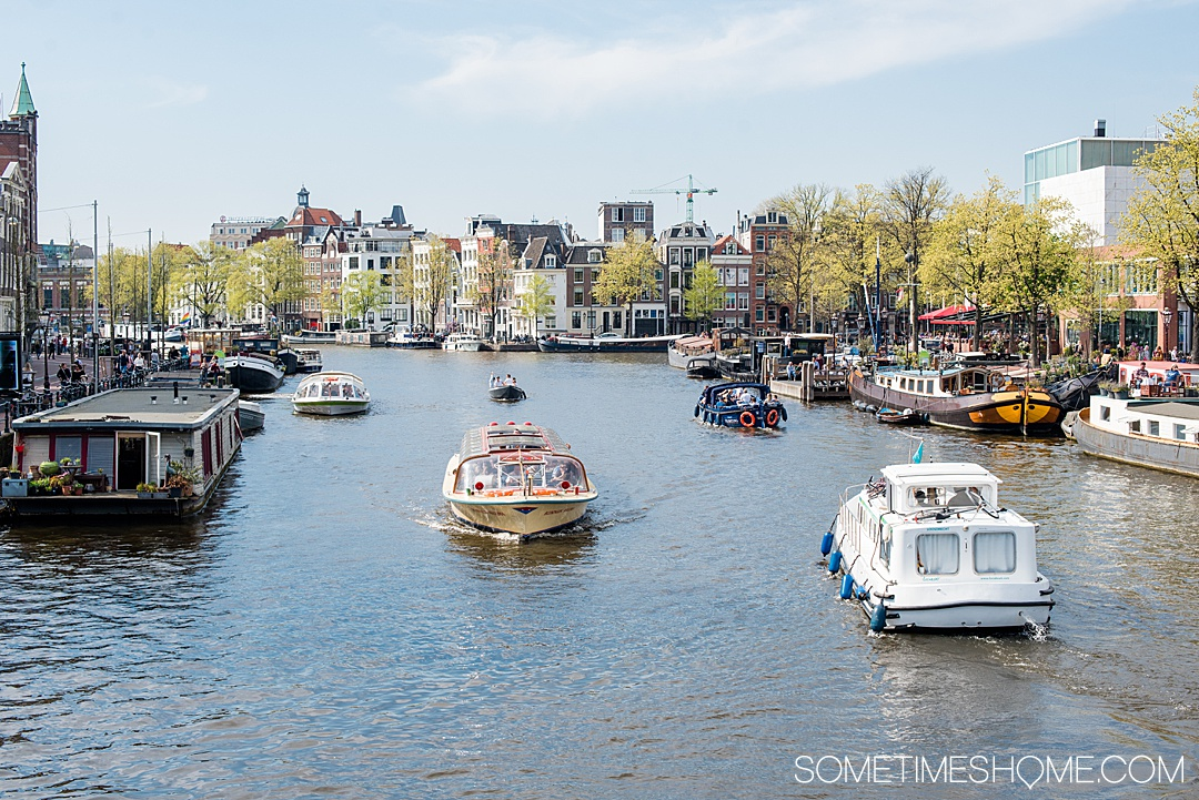 Amsterdam river cruise in The Netherlands and beautiful Belgium with tulips in bloom and a lot of charming European port cities to visit you wouldn't otherwise think of. We traveled with Emerald Waterways for 8 days of destinations and exploring in Europe day and night, with adventure to explore on the ships and in each city. #SometimesHome #SometimesHomeEurope #AmsterdamRiverCruise #EuropeanRiverCruise #AmsterdamTulips