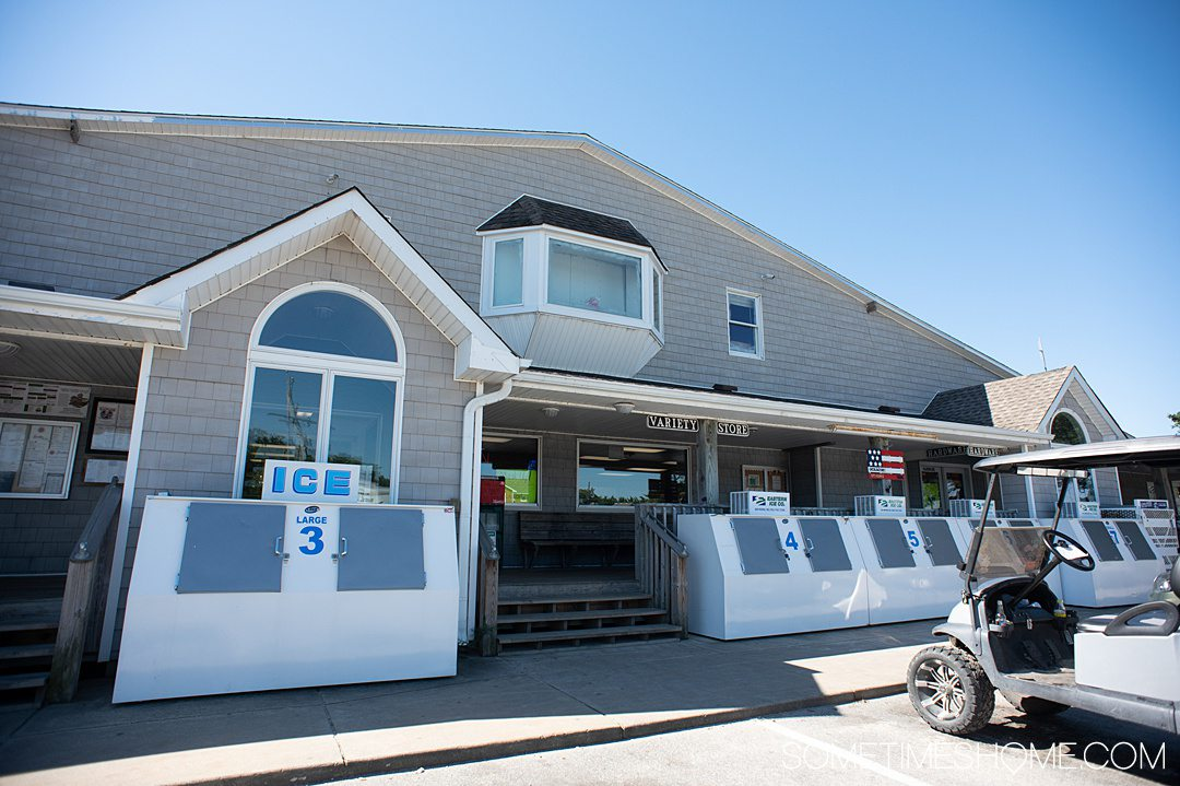 Gray and white building that is a grocery store on Ocracoke island in the Outer Banks, NC.
