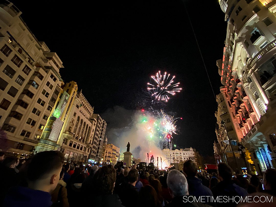 The city comes together to watch the Mascleta fireworks show in Valencia for Fallas one evening.