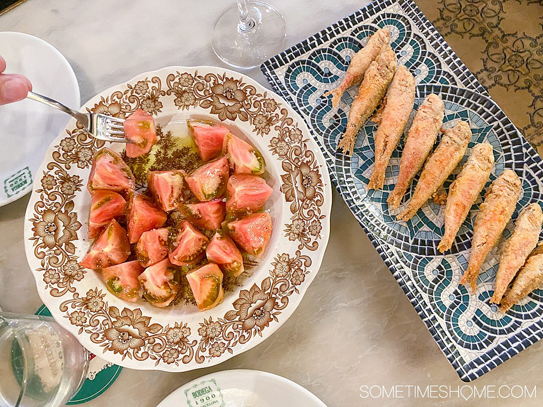 Sliced tomatoes and fried sardines in Barcelona