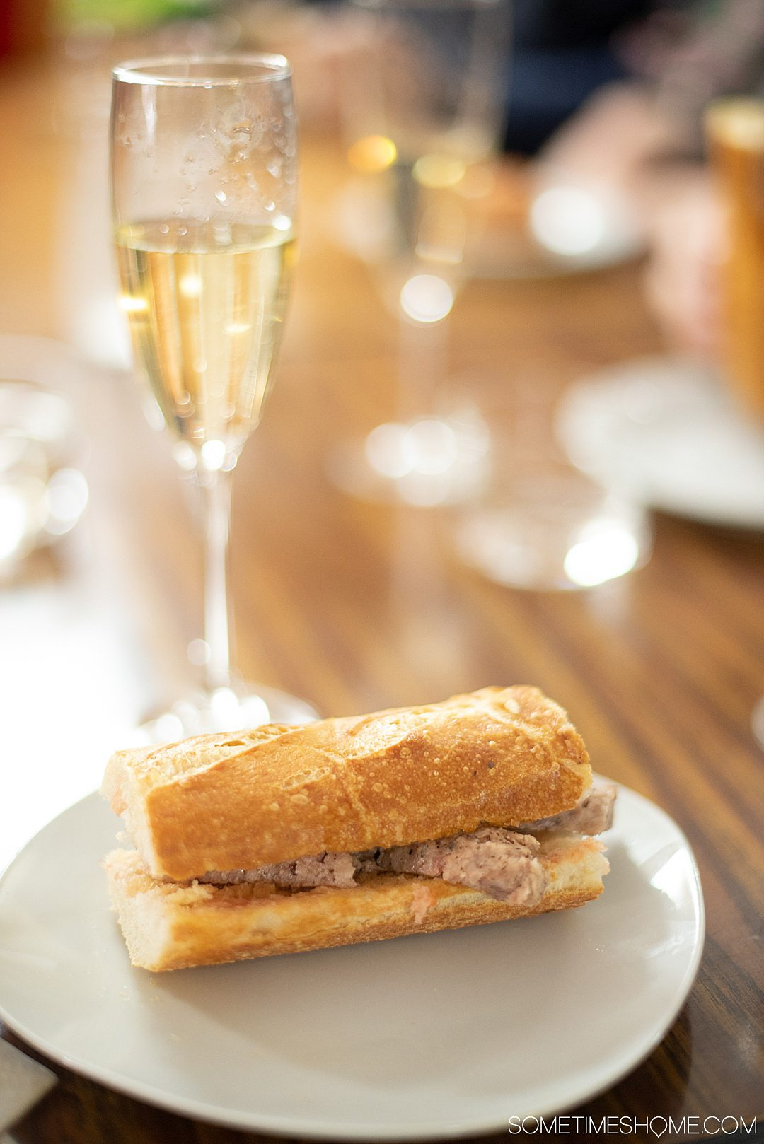 Spanish sandwich with meat (pork) and a glass of cava