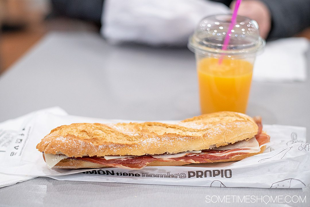 A ham and cheese baguette with fresh squeezed orange juice in Barcelona