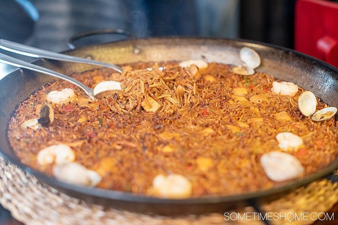 Fiduo noodles in a paella pan - must eat food in Barcelona