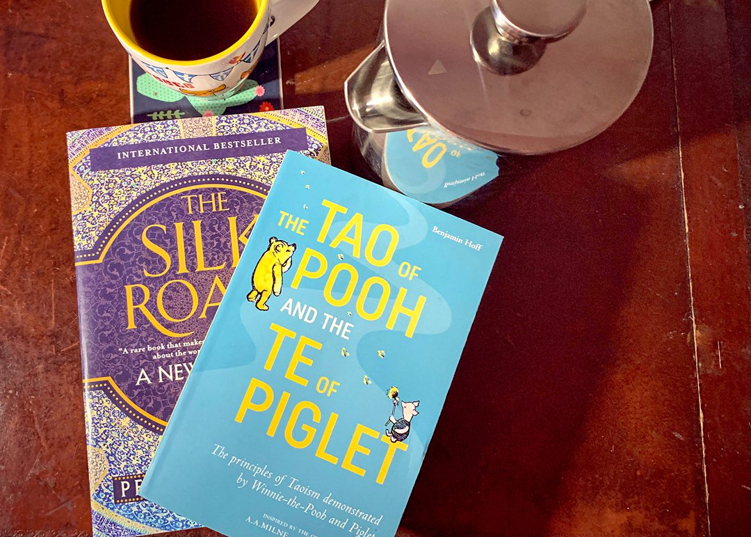 Tao of Pooh and Silk Road Books with tea.